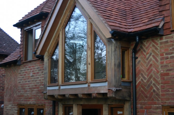 oak  windows fitted in a green oak frame